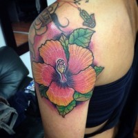 Mesmerizing colored hibiscus flower Hawaiian themed tattoo on shoulder with violet haze