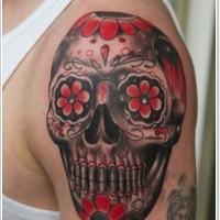 Mexican black red sugar skull tattoo on shoulder
