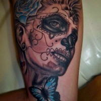 Mexican skull girl and blue butterfly and rose tattoo