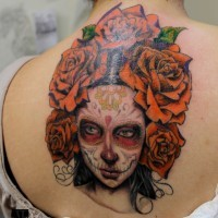 Mexican skull girl with big roses tattoo