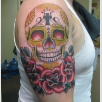 Mexican skull with red roses tattoo on shoulder