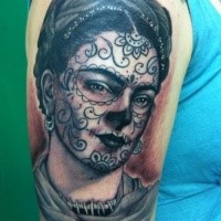 Mexican style black ink thigh tattoo of woman with earrings