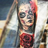 Mexican style colored arm tattoo of Woman with rose