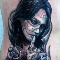 Mexican style colored back tattoo of woman portrait
