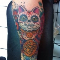 Mexican style colored forearm tattoo of maneki neko japanese lucky cat with golden tablet