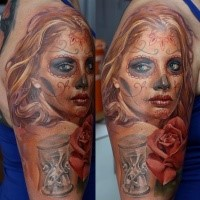 Mexican style colored shoulder tattoo of woman portrait with rose flowers and sand clock