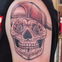 Mexican style smiling skull in baseball cap funny idea of shoulder tattoo