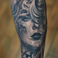 Mexican traditional black and white forearm tattoo of woman portrait