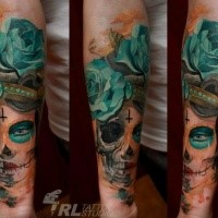 Mexican traditional colored forearm tattoo of woman portrait with flowers