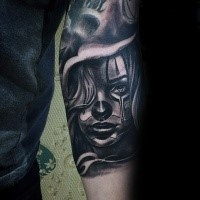 Mexican traditional colored forearm tattoo of woman face in fog