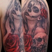Mexican traditional colored woman portrait with red rose and skull tattoo on shoulder