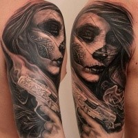 Mexican traditional style black ink shoulder tattoo of woman with pistol