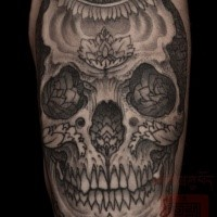 Mexican traditional style colored arm tattoo of human skull with flowers
