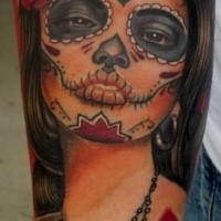 Mexican traditional style colored arm tattoo of beautiful woman face with flower
