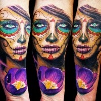 Mexican traditional style colored arm tattoo of woman face with flower
