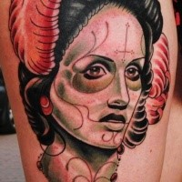 Mexican traditional style colored thigh tattoo of woman portrait with feather