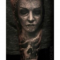 Mexican traditional style detailed arm tattoo of woman portrait with human skull