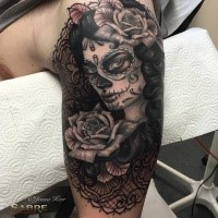 Mexican traditional style upper arm tattoo of woman portrait with big rose by Jenna Kerr