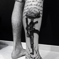 Military themed dramatic black ink tattoo with lettering and rifle on leg
