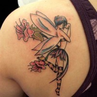 Mischievous fairy tattoo on shoulder blade