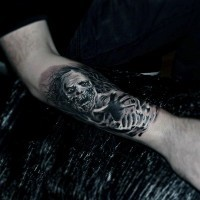 Modern horror movie like black and white forearm tattoo of monster ghost