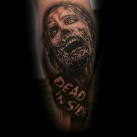 Modern horror movies like black and white leg tattoo of zombie face with lettering