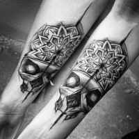 Modern sketch style painted by Inez Janiak tattoo of human skull with ornamental flower