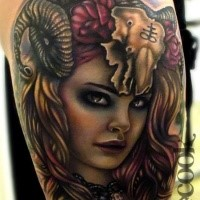 Modern style colored devil woman tattoo on thigh