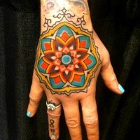 Modern style colored hand tattoo of big ornamental flower