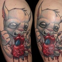 Modern style colored maniac mouse tattoo on shoulder with human heart