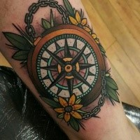 Modern style colored tattoo of compass with chain and flowers