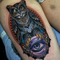 Modern style colored thigh tattoo of amazing owl with magical orb
