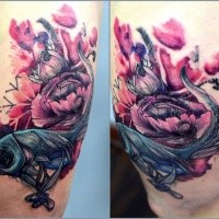 Modern style colored thigh tattoo of funny fish with flowers by Joanna Swirska