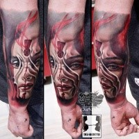 Modern traditional style colored forearm tattoo of woman face with key hole