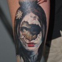 Modern traditional style colored forearm tattoo of creepy woman with butterfly