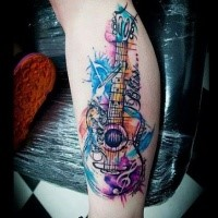 Modern traditional style colored leg tattoo of cool guitar with lettering