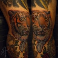 Modern traditional style colored leg tattoo of tiger head