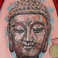 Monumental Buddha's portrait colored detailed shoulder Buddhist tattoo
