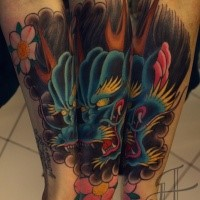 Multicolored mystical Asian oriental style Hanya tattoo with pink blossoms on leg