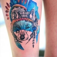 Multicolored thigh tattoo of Indian wolf with helmet by Joanna Swirska