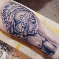 Muscular Spartan warrior in helm pale colored detailed tattoo