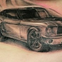 Mustang car tattoo on stomach