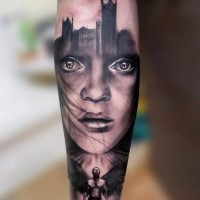 Mysterious black and white forearm tattoo of woman portrait combined with angel and Big Ben