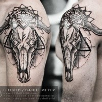 Mysterious black ink shoulder tattoo of large animal skull with geometrical ornaments