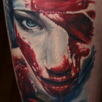 Mysterious horror movie like colored bloody woman tattoo on thigh