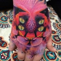 Mysterious multicolored hand tattoo of creepy cat