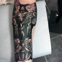 Mystic black ink angel tattoo on forearm with burning candles and flowers