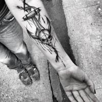Mystical black ink forearm tattoo of big anchor with skull by Inez Janiak
