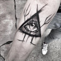 Mystical blackwork style designed by Inez Janiak forearm tattoo of big triangle with eye