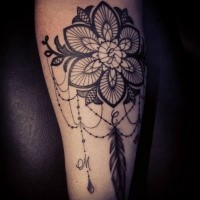 Mystical blackwork style tattoo of large flower with feather by Caro Voodoo